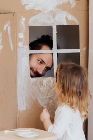 father and daughter playing house