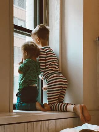 siblings looking out the window