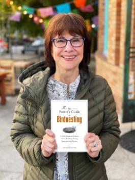 Dr. Ann Buscho with book